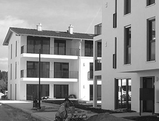 """Geschosswohnungsbau am Isarstausee – 7 Mehrfamilienhäuser mit ca. 60 Wohneinheiten in Wackersberg, """"Am Hoheneck""""; Bauherr: Gemeinde Wackersberg"""